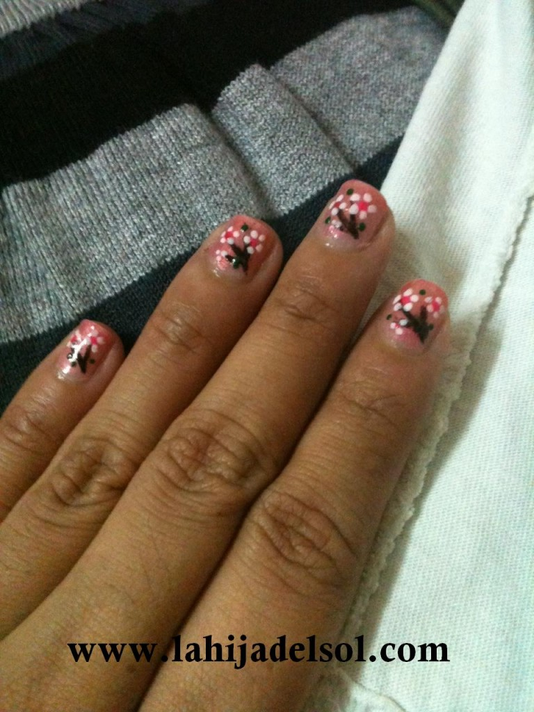 Cherry blossom-inspired nail art